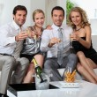 Two couples drinking champagne at home — Stock Photo #7026020