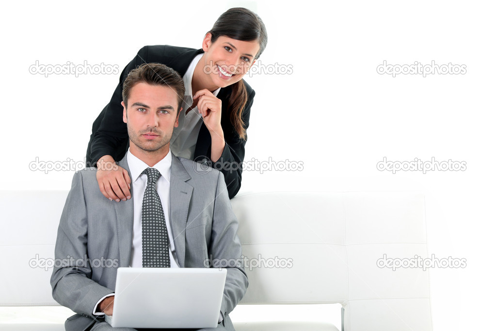Business couple looking at a laptop — Stock Photo #7025854