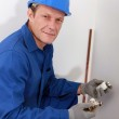 Plumber fixing heating system — Stock Photo