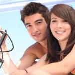 Young couple sailing a catamaran — Stock Photo