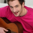 Man with acoustic guitar — Stock Photo