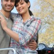 Royalty-Free Stock Photo: Smiling couple sitting on a scooter