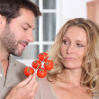 Couple and tomatoes — Stock Photo