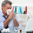 Stock Photo: Office worker suffering from cold
