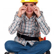 A sobbing tradeswoman — Stock Photo