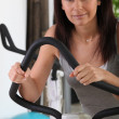 Royalty-Free Stock Photo: Brunette in gym using stepper machine