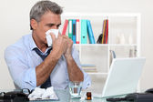 Office worker suffering from a cold — Stock Photo