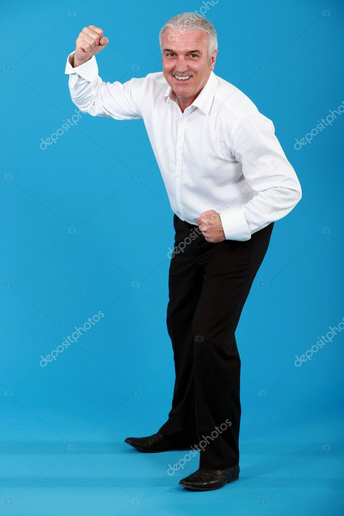 Man in a suit dancing  Stock Photo #7089857