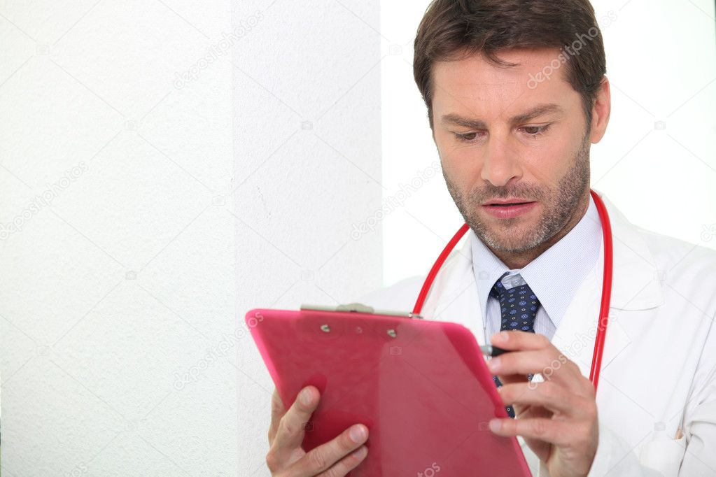 Doctor checking notes — Stock Photo #7089927