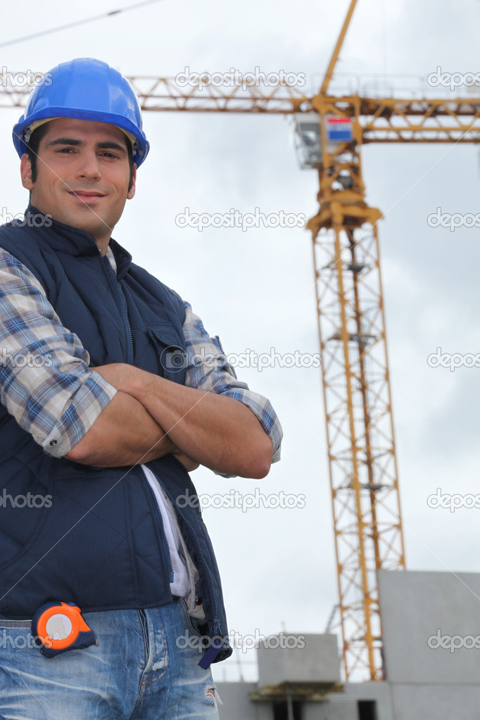 Construction worker in front of a crane — Stock Photo #7089946