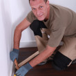 A man laying parquet. — Stock Photo #7132563