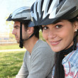 Stock Photo: Young couple wearing cycle helmets