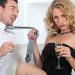 Stock Photo: Womseducing mwith champagne