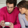 Young man and young woman playing video games — Stock Photo
