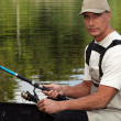 45 years old man on a boat and fishing — Stock Photo #7133432