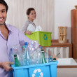 Couple doing recycling -  