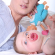 Woman playing with her baby - Stock Photo