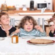 Kids having pancakes for breakfast — Stock Photo