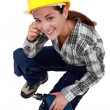 Royalty-Free Stock Photo: A female construction worker with a drill.