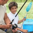 Father and son fishing together — Stock Photo #7133984