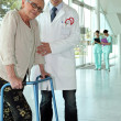 Helpful doctor and senior woman with walker — Stock Photo #7134354