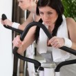 Woman working out at the gym — Stock Photo #7134559