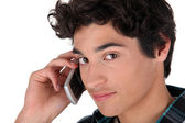 Young man using a cellphone — Stock Photo