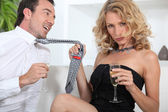 Woman seducing a man with champagne — Stock Photo