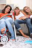 Three young housemates doing the chores — Stock Photo