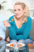 Woman eating a meal — Stock Photo