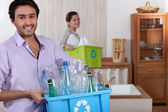 Couple doing recycling — Stock Photo