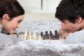 Man and woman playing chess — Stock Photo