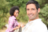 Couple relaxing in the countryside — Stock Photo