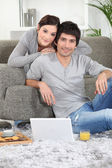 Portrait of a young couple at home — Stock Photo