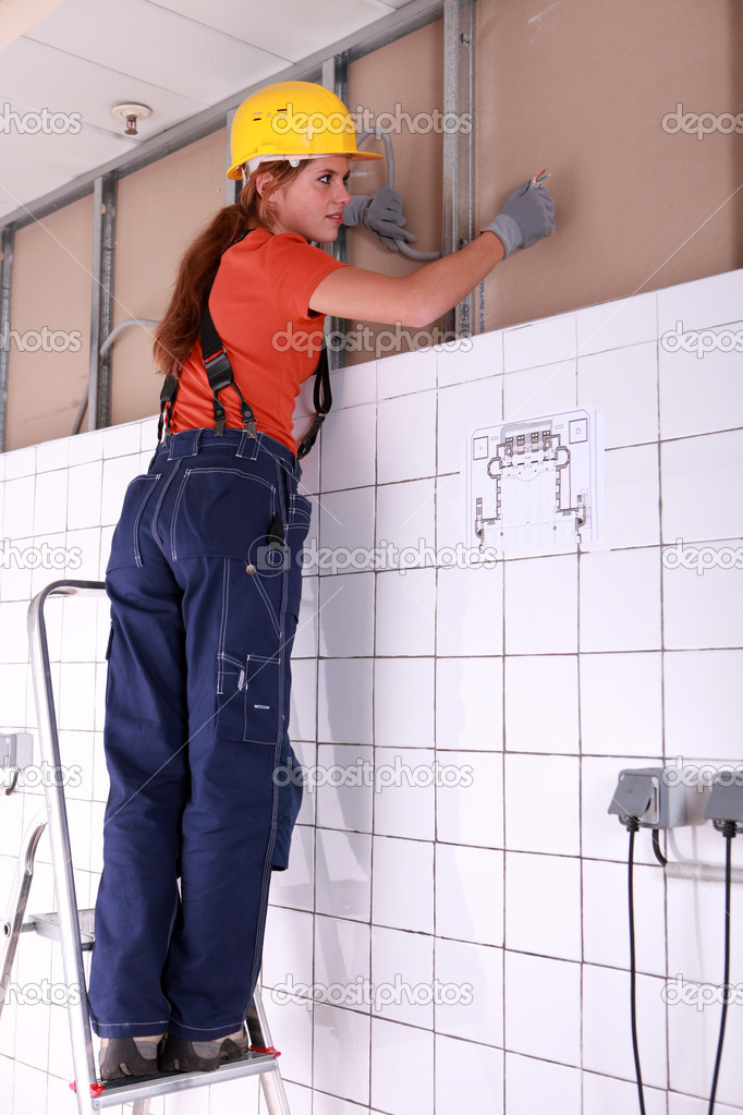 Female artisan installing wiring system — Stock Photo #7132449