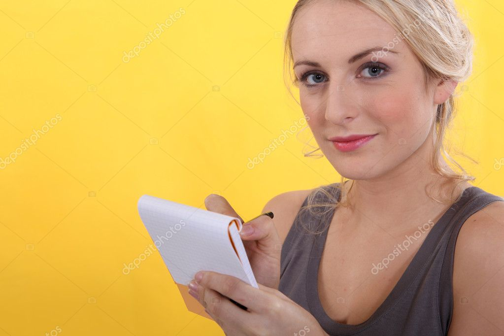 Portrait of a woman with shopping list  Stock Photo #7132902