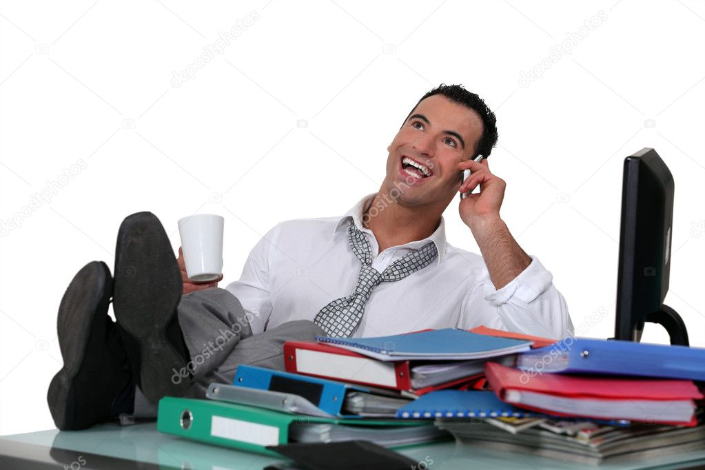 Casual office worker with feet on desk — Stock Photo #7132995