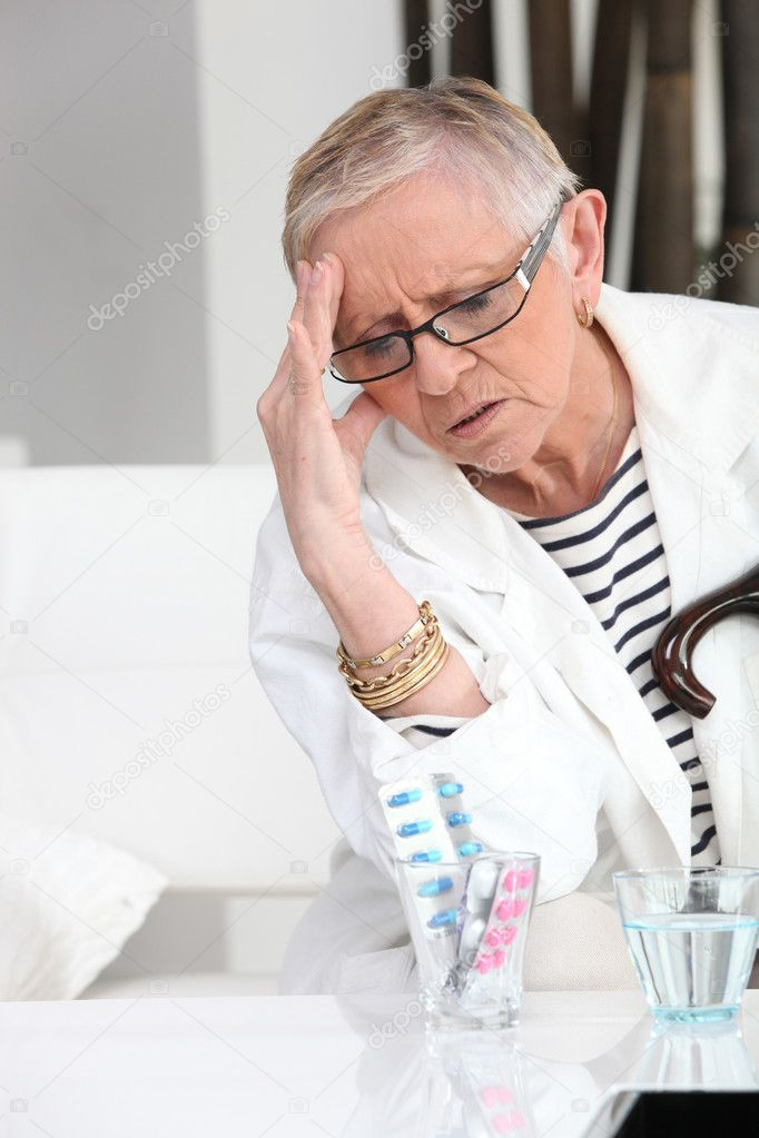 Older woman with a headache — Stock Photo #7133041