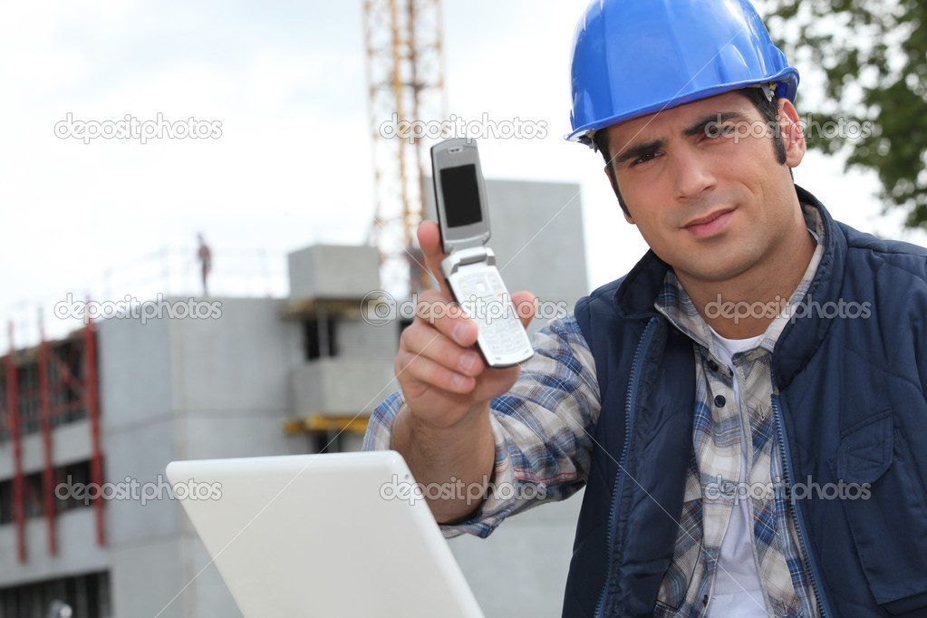 Foreman on construction site holding telephone — Stock Photo #7134655