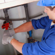 Plumber installing pipes — Stock Photo