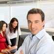 Manager and employees in office — Stock Photo