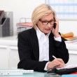 Womon phone in her office — Stockfoto #7230377