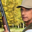 Hunter with a shotgun — Stock Photo