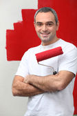 Man happy to paint his wall — Stock Photo