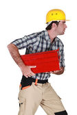 Craftsman running and holding a toolbox — ストック写真