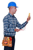 Electrician surprised by the results of his measurements — Stock Photo