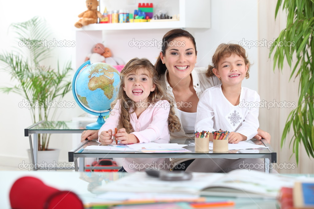 Portrait of a teacher with her pupils — Stock Photo #7230526