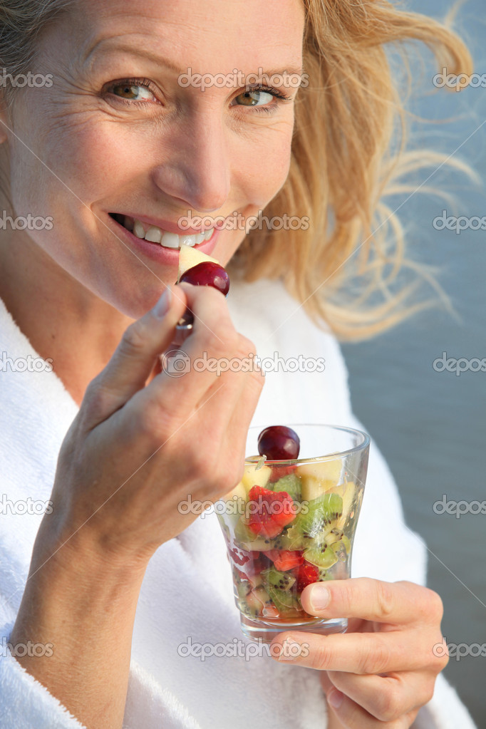 Senior woman eating fruit salad — Stock Photo #7230605