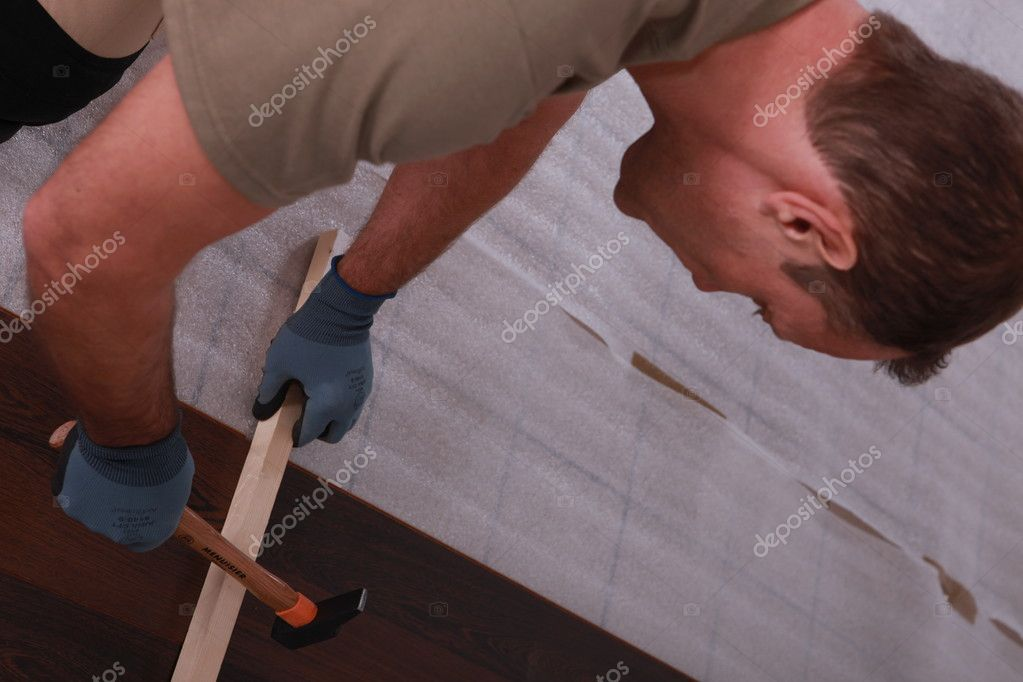 A handyman putting floorboards — Stock Photo #7320879