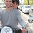 Stock Photo: Couple on scooter